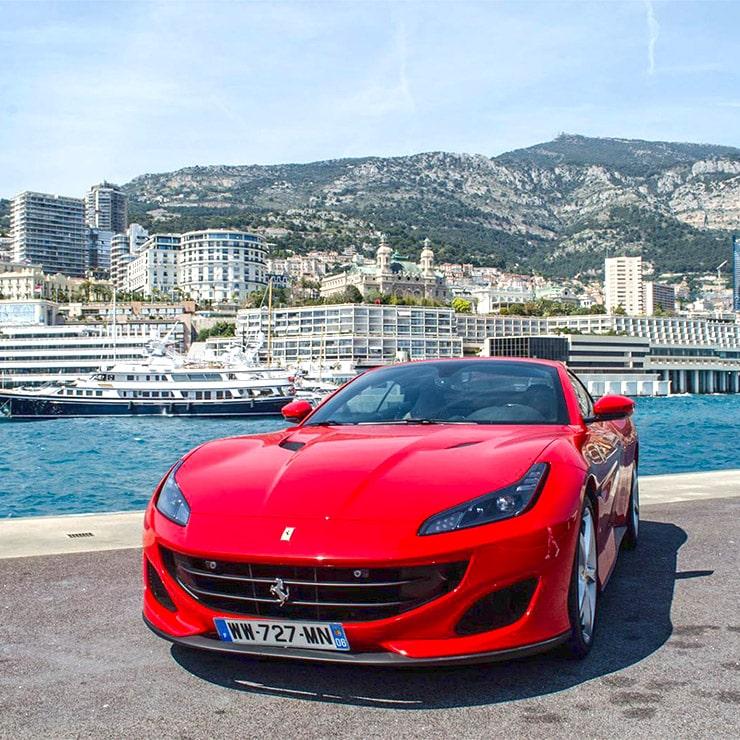 Luxury Ferrari car in Monaco harbor