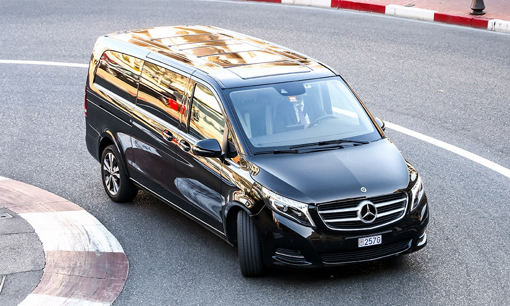 Mercedes V Class with driver in the centre of Monaco, French Riviera