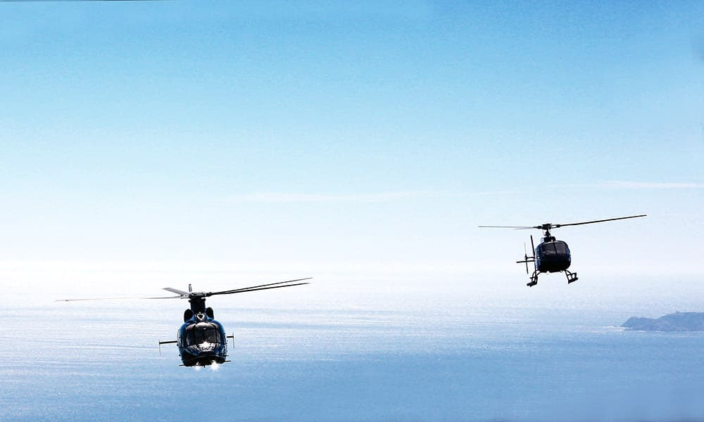 Two helicopters flying over the French Riviera