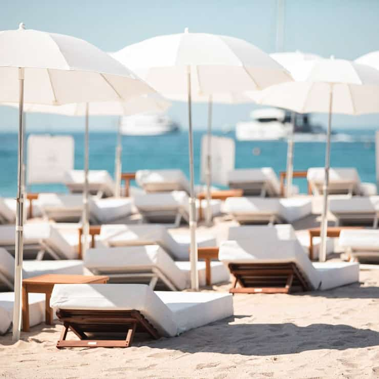 Deckchair and mattress on a private beach in Cannes, French Riviera