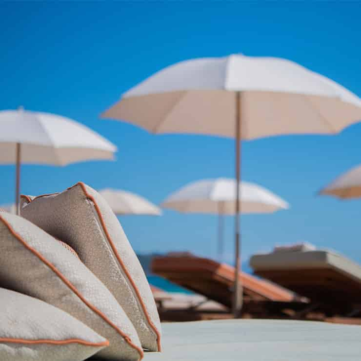 Deckchairs and parasols on a private beach on the French Riviera, South of France