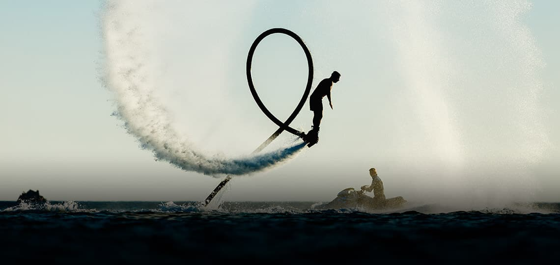 Young man flyboarding on the French Riviera