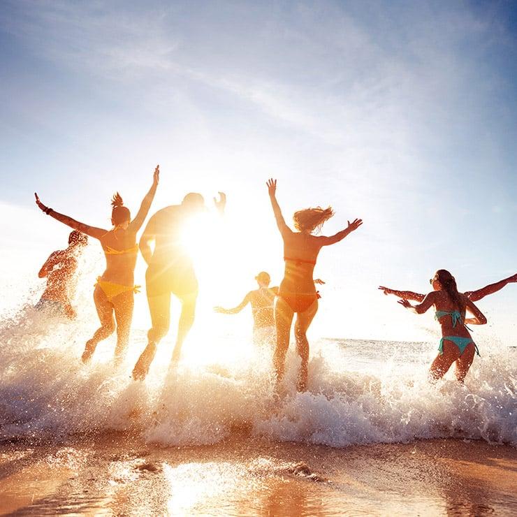 Holidaymakers enjoying the sea on a beach near Monaco, French Riviera