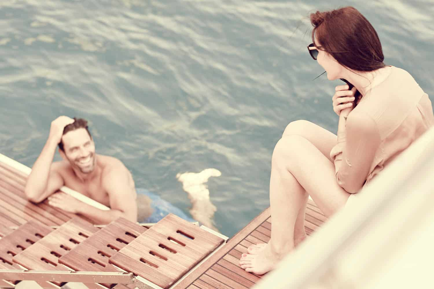 Young couple swimming during their yacht charter
